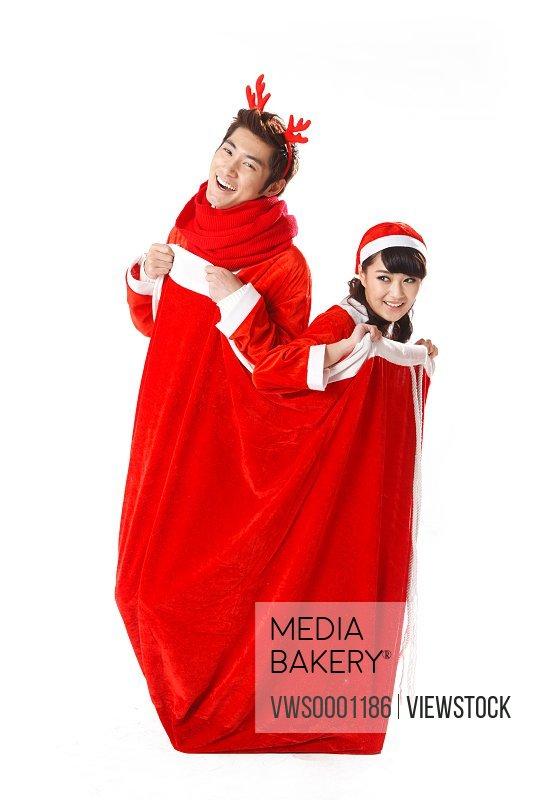 Young couple celebrating Christmas