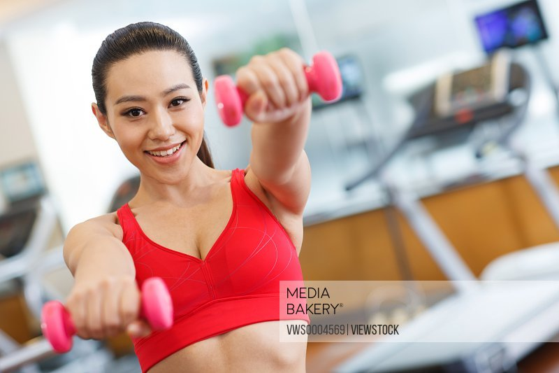 Young woman in fitness