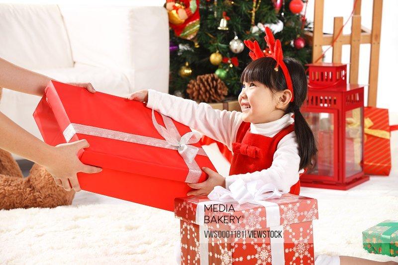 Girl receive Christmas gift