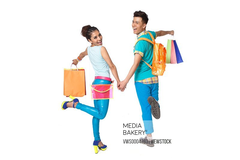 Fashionable young people shopping