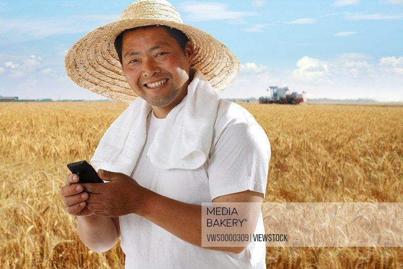 Farmer holding cell phone