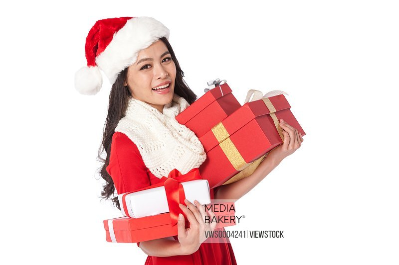 Young woman holding Christmas presents