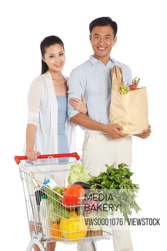 Young couple shopping with shopping cart