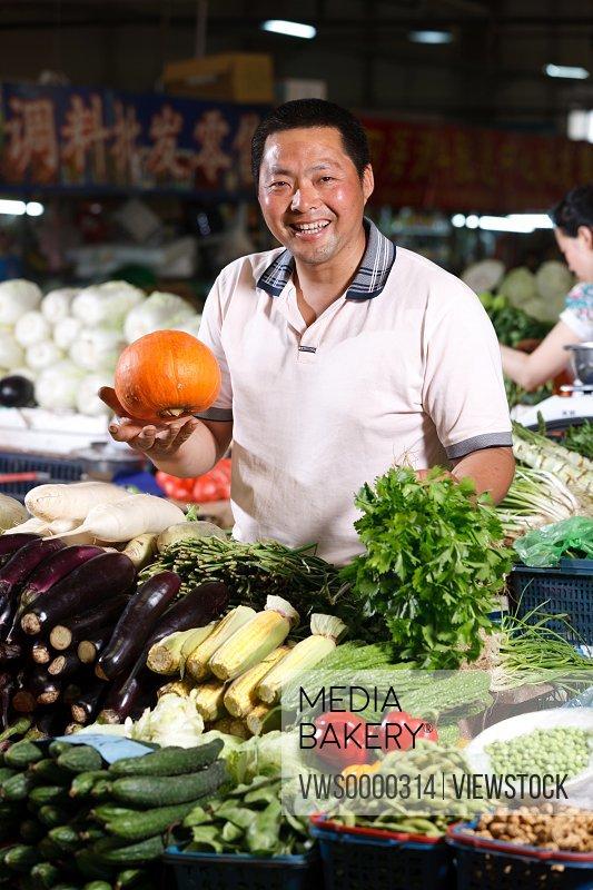 Farmer selling vegetables in food market