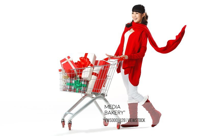 Young woman shopping with shopping cart