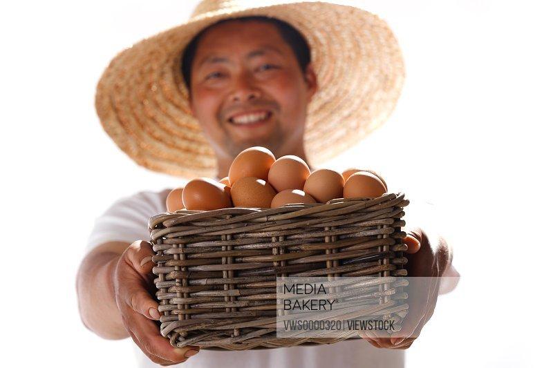 Farmer holding basket of eggs
