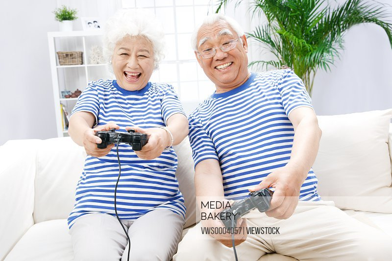 Old couple play video games