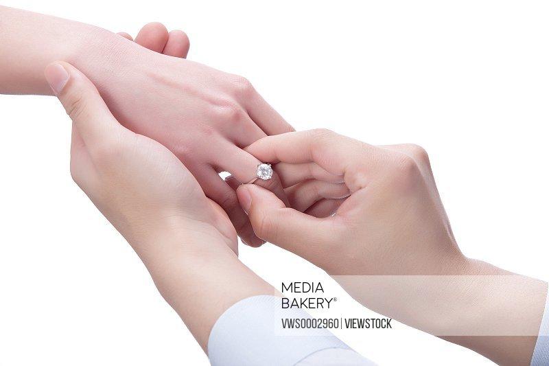 Man wearing ring to woman