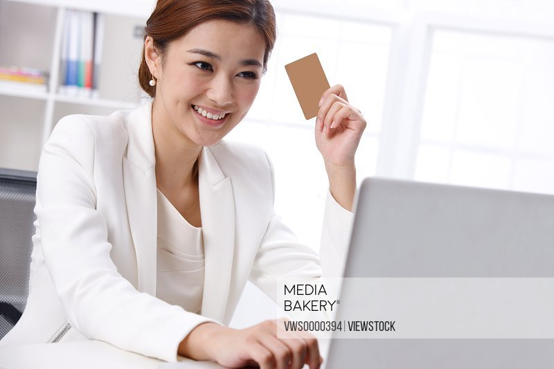 Young business lady holding card