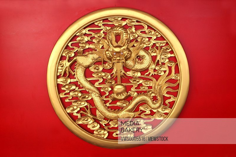 Dragon carving on red background