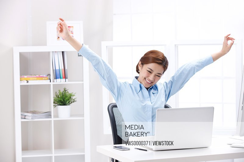 Young business lady stretching