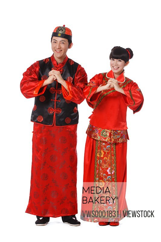 Young couple dressed in Chinese traditional clothes celebrating Chinese New Year