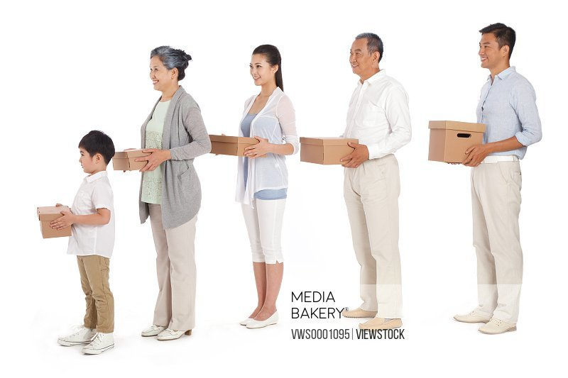 Whole family holding boxes