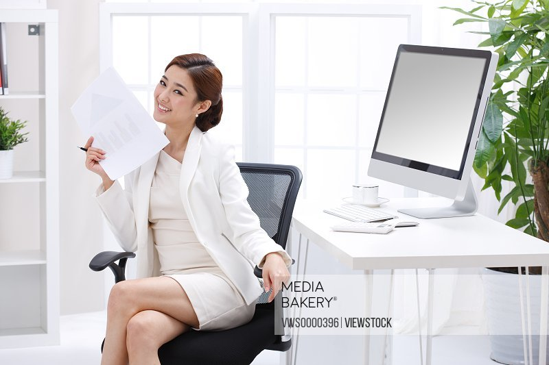 Young business lady sitting in front of computer