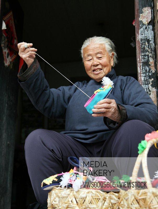 mature woman making shoes
