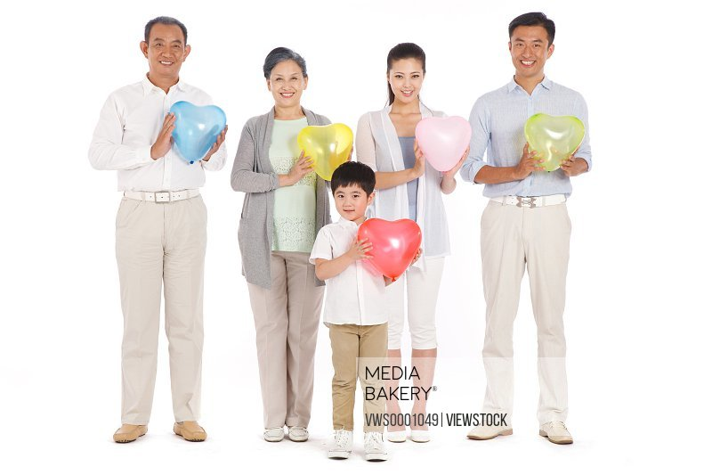 Whole family holding heart-shaped balloon
