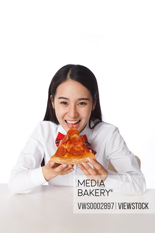 Girl holding a piece of pizza