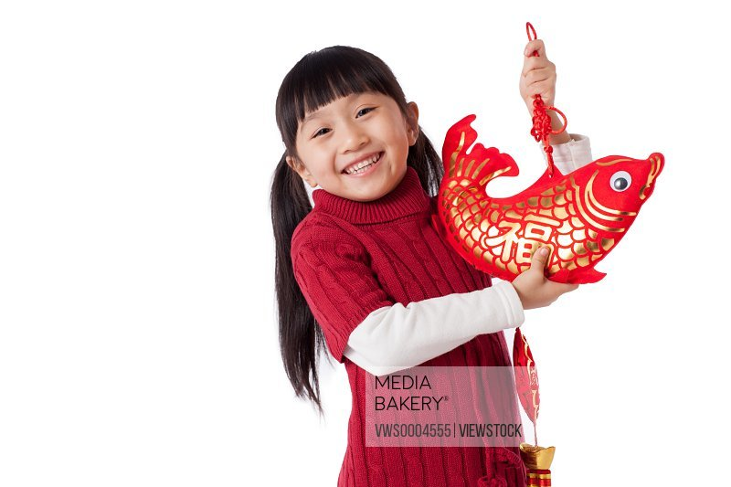 Oriental girl holding a New Year decorations
