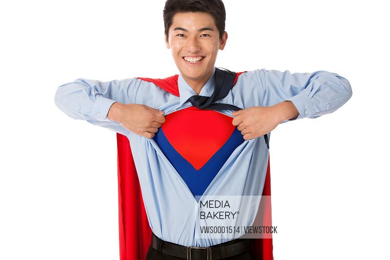 Young man in superman outift