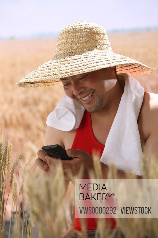 Farmer holding cell phone