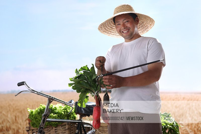 Farmer weighting vegetables
