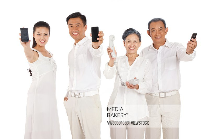 Old couple and young couple holding cell phone