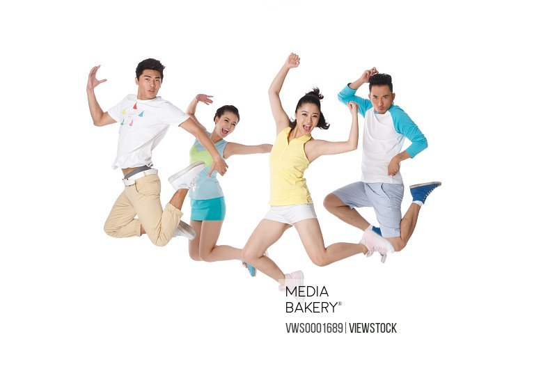 Young people jumping in studio