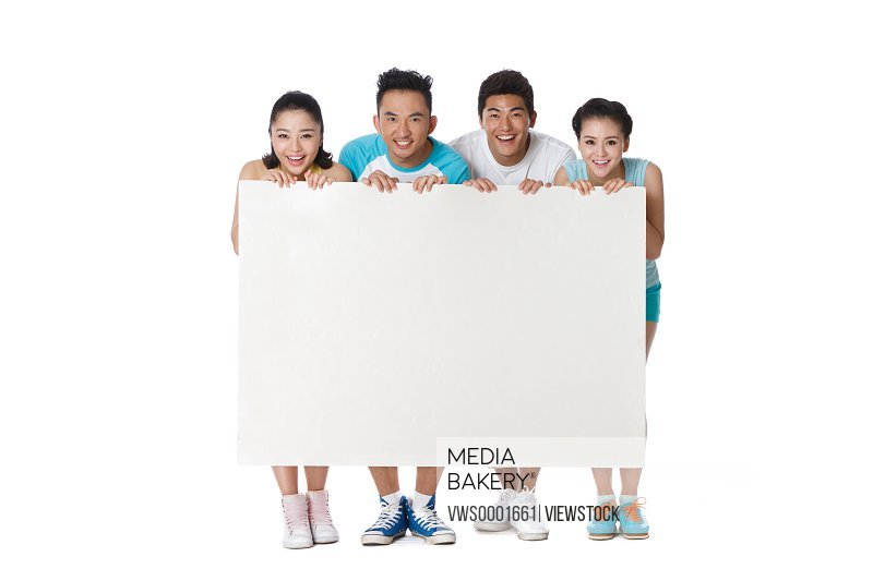Portrait of young people holding white board