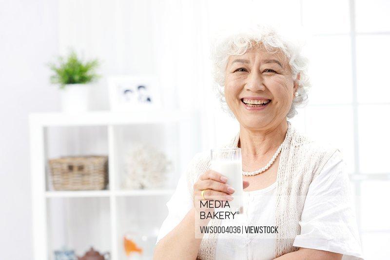 An old woman having milk