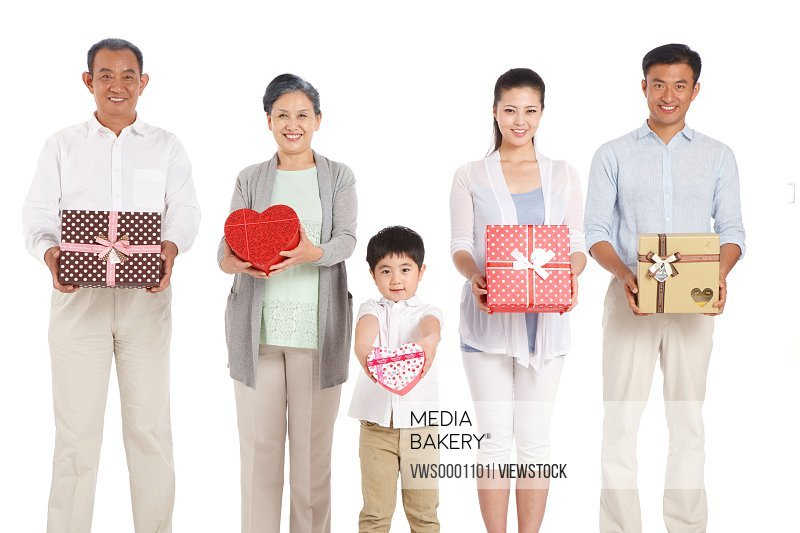 Whole family holding gift boxes