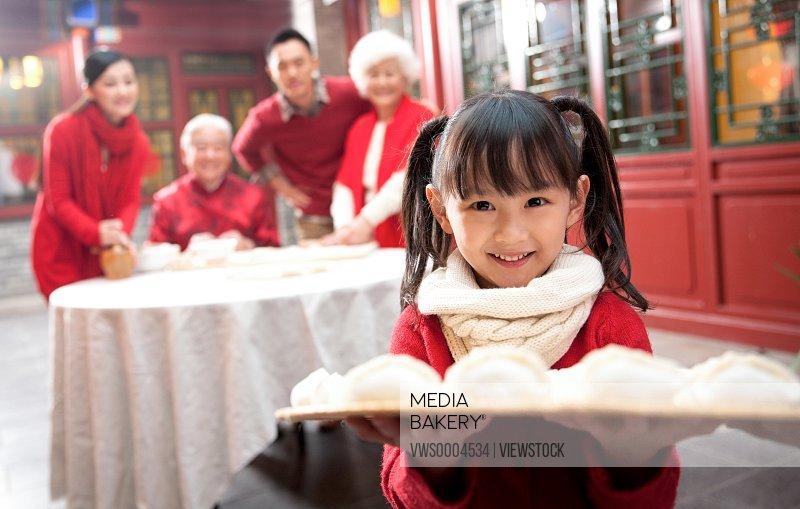 Oriental New Year family prepare reunion dinner