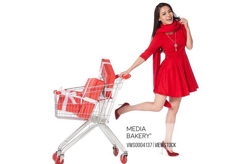 Young woman pushing a shopping cart