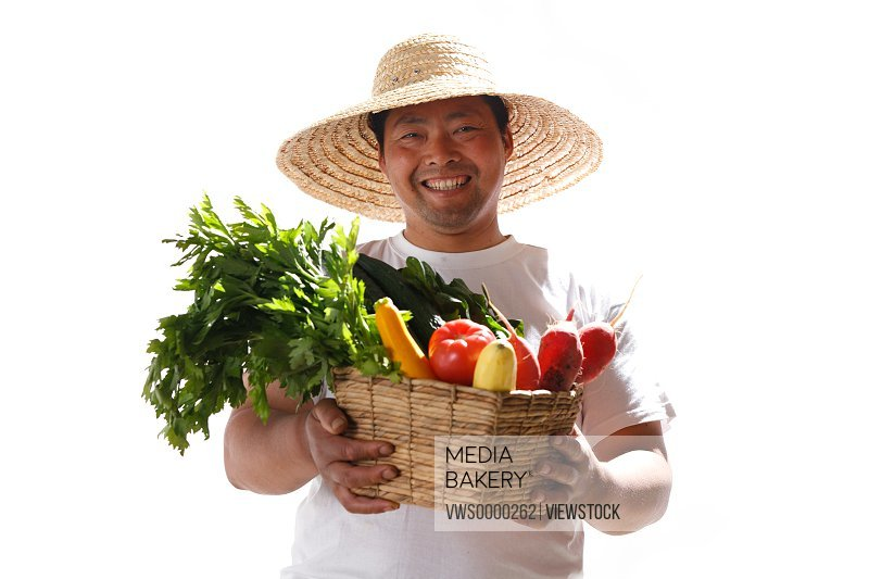 Farmer holding basket of vegetables