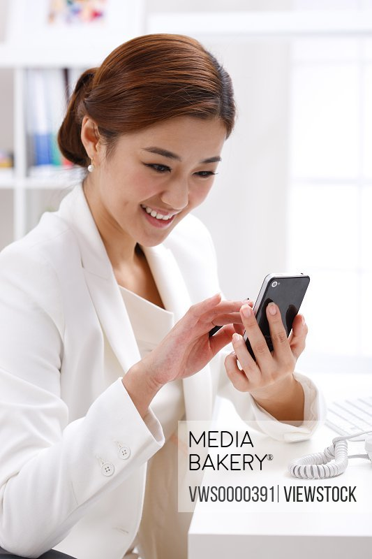 Young business lady using cellphone