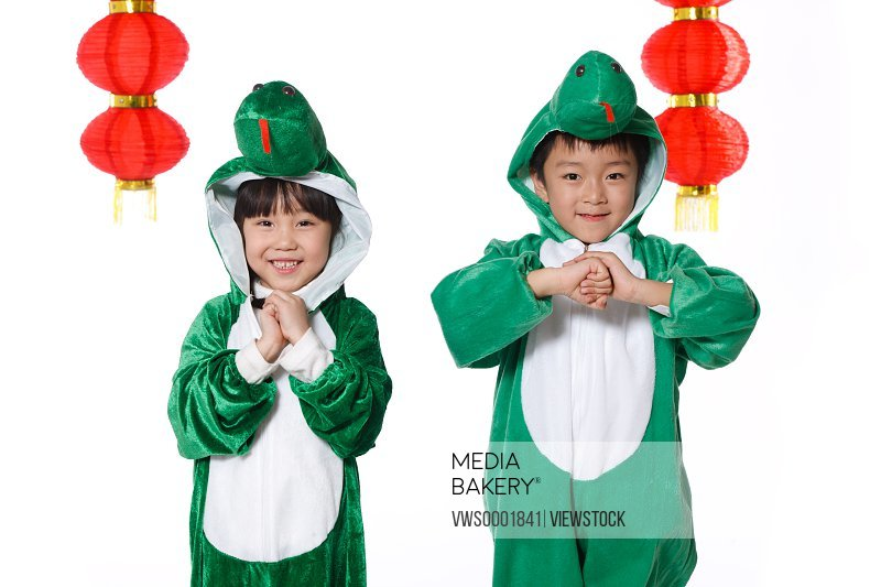 Boy and girl celebrating Chinese New Year