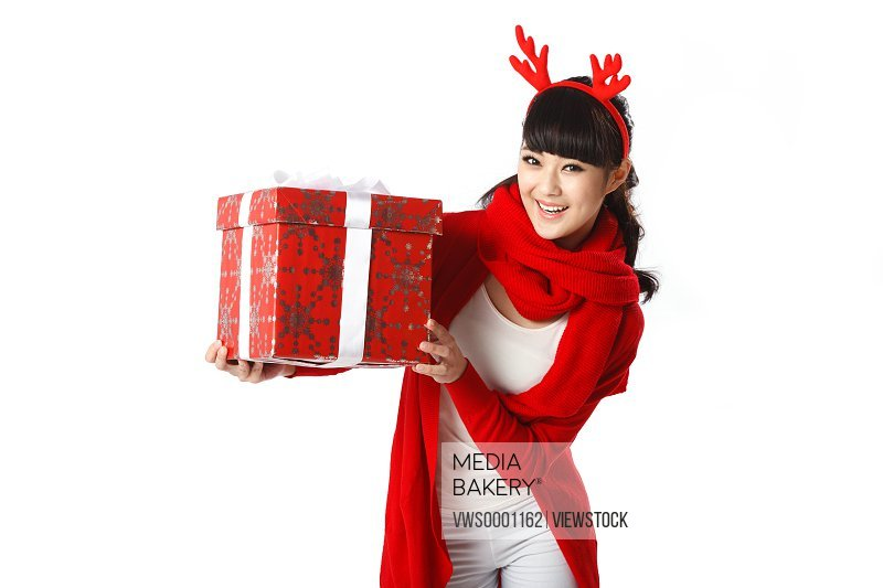 Young woman holding Christmas gift