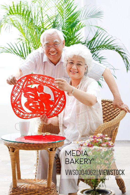 Old couple holding Fu character