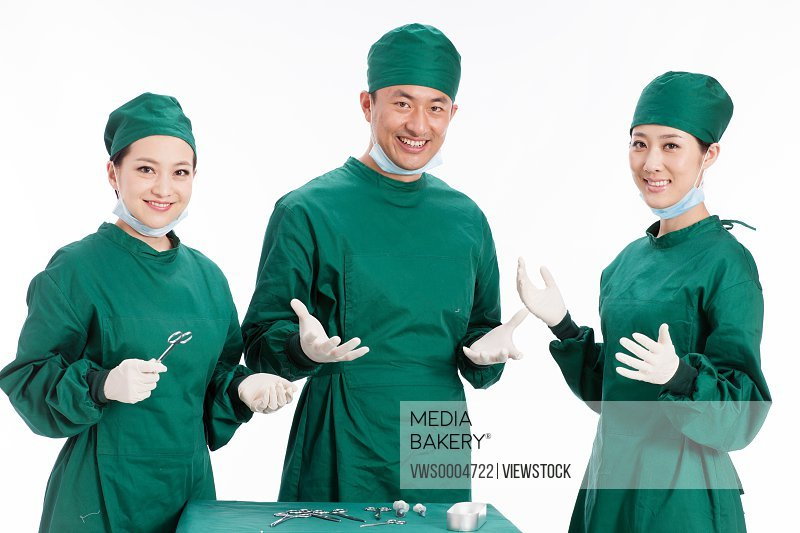Three portrait of doctors on white background