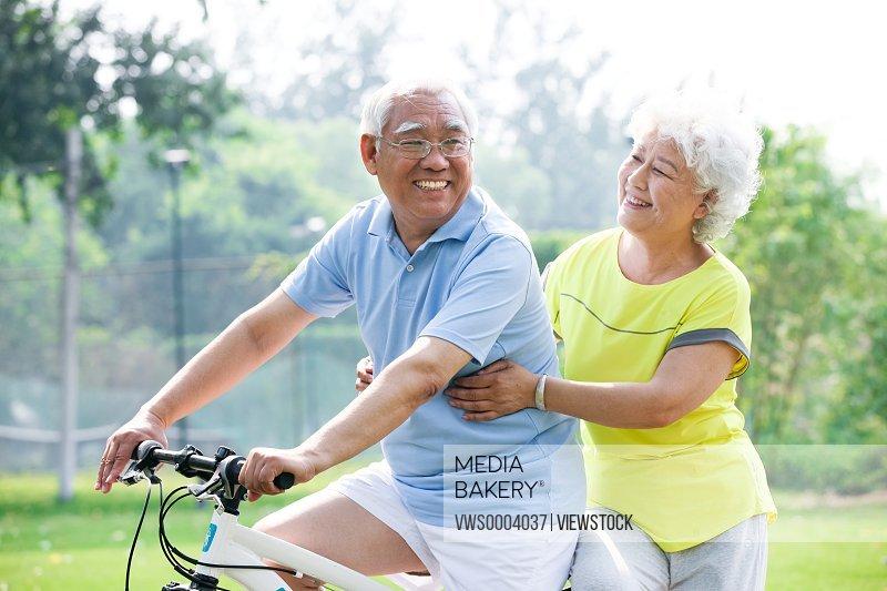 Old couple on bike