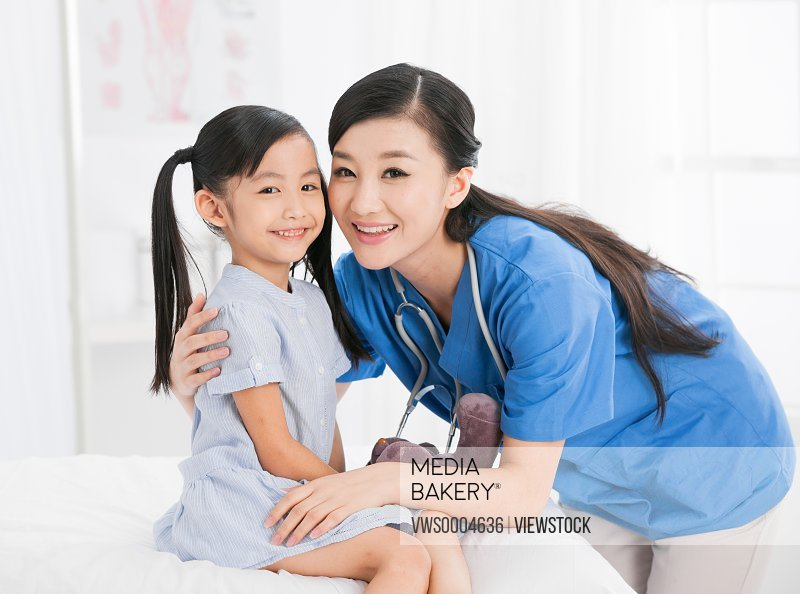 Female doctor and child