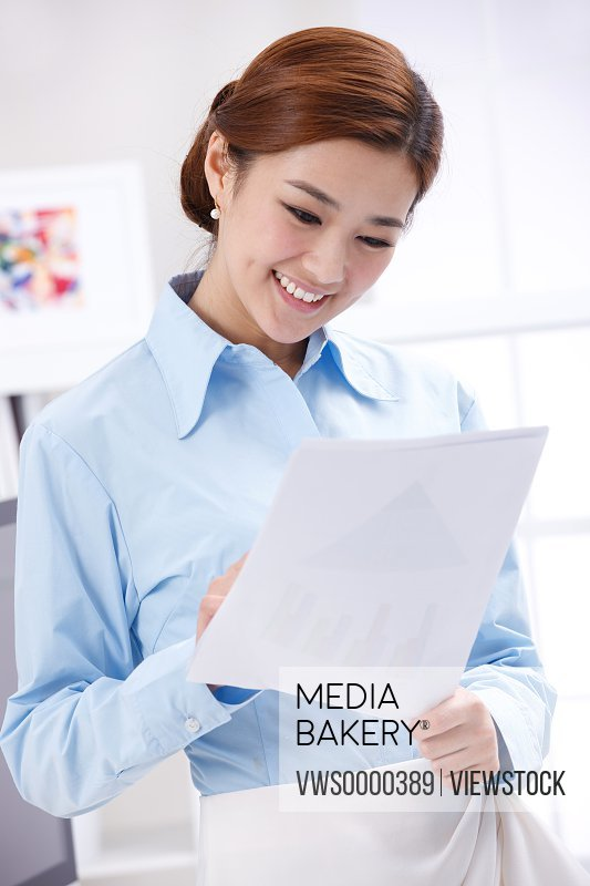 Young business lady holding paper