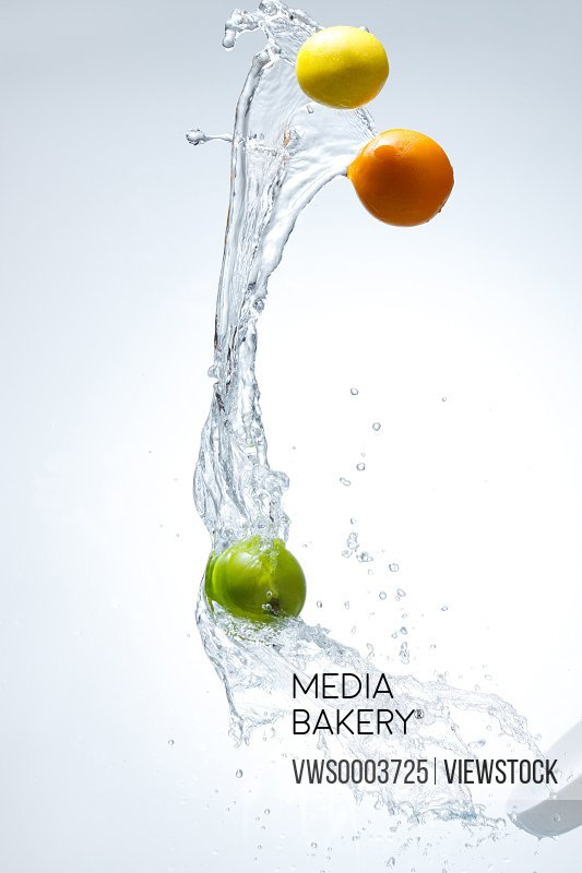 Splashed water and fruits