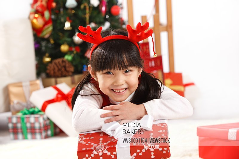 Girl and Christmas gift