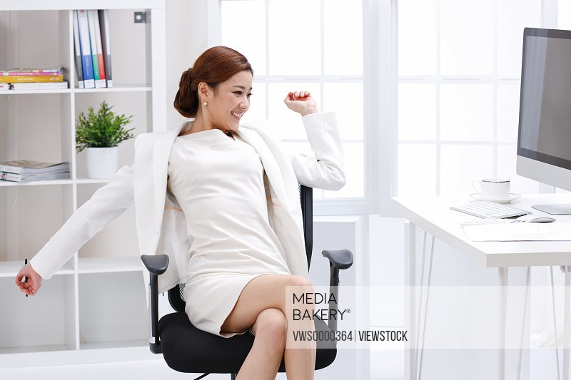 Young business lady sitting in office