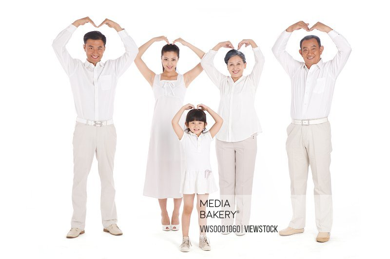 Whole family making heart shape with hands