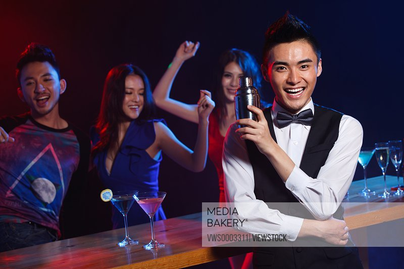 Bartender with young people