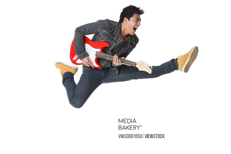 Young man playing guitar isolated on white background
