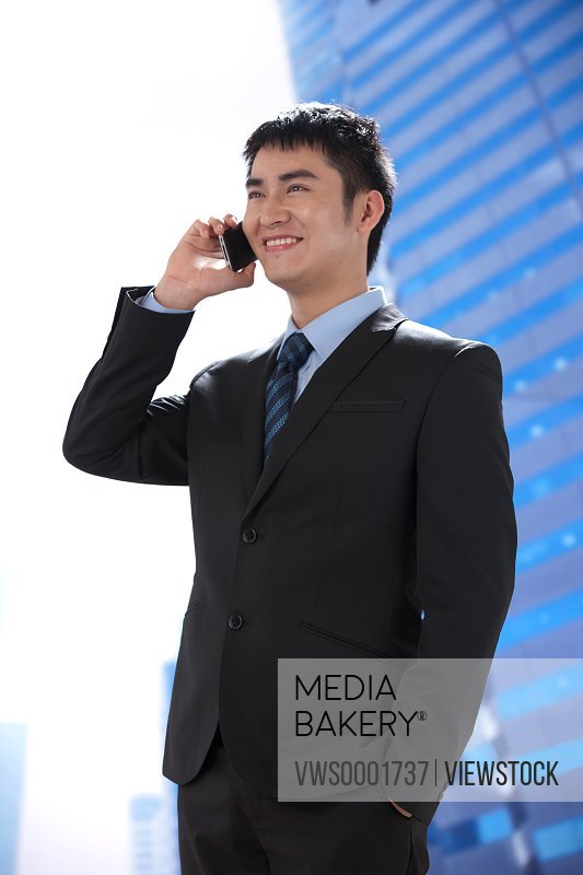 Young businessman using mobilephone