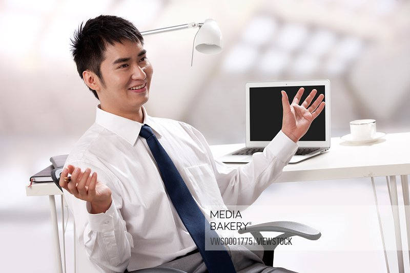 Young businessman working at office