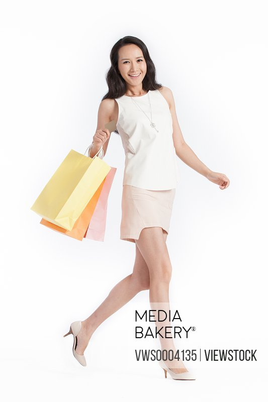 Happy young female white-collar shopping
